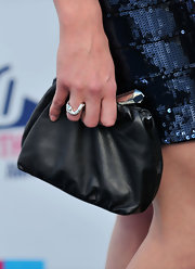 Yvonne showed off her leather clutch, which she paired with a navy sequined dress.