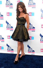 Paula opted for a lace-overlaid, bustier-style cocktail dress with platform slingbacks.
