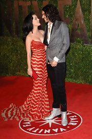 An elated Katy Perry looked stunning in a bold Zuhair Murad gown and a bright red crystal encrusted long clutch.