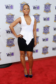 Trina showed off her plunging blouse, which she paired with a black mini skirt.