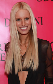Karolina Kurkova showed off a sleek a shiny center part blond locks while attending the Victoria's Secret Fashion Show.
