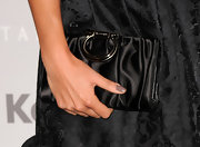 Actress Nikki Reed paired her Marc Jacobs dress with a satin ruched clutch.