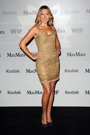 Singer Colbie Caillat showed off her sexy side while hitting an LA event in a gold sequin dress.