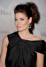 Debra Messing showed off her gemstone and diamond earrings while hitting the 2010 Crystal + Lucy Awards.
