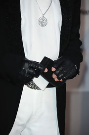 Karl showed off her fingerless gloves while attending the amFAR event in France.