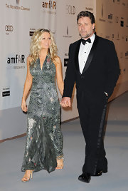 Russell wore a classic black tuxedo that complemented his date's evening gown.