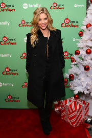 Ashley Benson added warmth to her monochromatic look with a long black wool coat with bold-shoulders.