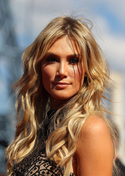 Delta Goodrem left her hair down in boho-chic waves for her ARIA Awards red carpet look.