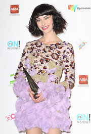 Kimbra's pink lipstick looked fabulous against her porcelain skin.