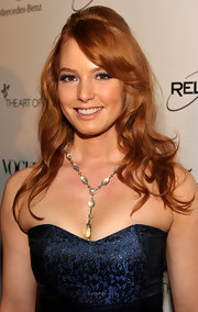 Alicia Witt accented her strapless neckline with a silver moonstone necklace with pearls and diamonds.
