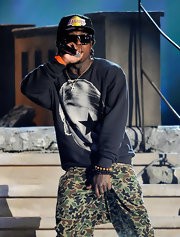 Lil Wayne wore a hoodless sweater for the his performance at the Billboard Music Awards.