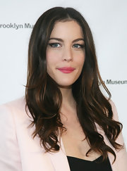Liv Tyler attended the 2011 Brooklyn Artists Ball with long cascading curls parted down the center.