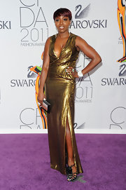 Estelle perfectly paired her strappy sandals with a Deluxe clutch with a sparkling clasp for the CFDA Awards.