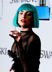 Lady Gaga showed off her famous talon nails that were coated in red paint at the 2011 CFDA Awards.