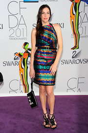 Liv Tyler took her knockout print dress to the next level at the CFDA Awards with modern strappy black ankle strap sandals.