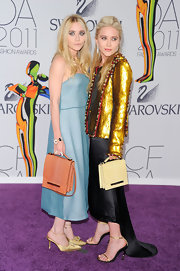 Ashley Olsen teamed her blue CFDA Awards frock with a peach leather flap bag.