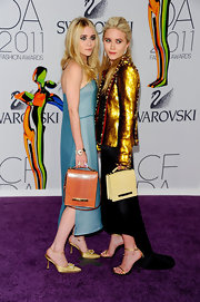 Mary-Kate Olsen carried a pale yellow leather flap bag to the 2011 CFDA Awards.