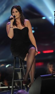 Hillary Scott wore a black lacy cocktail dress in a sleek strapless silhouette for the CMT Artists of the Year.