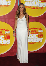 Sheryl Crow was looking as beautiful as ever at the CMT Awards in a white Catherine Malandrino design with a colorful beaded hip detail. The songstress looked sun kissed with a glowing tan and her signature long wavy locks.