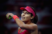 Tennis pro Ana Ivanovic wore a bright pink sun visor while playing in the China Open.