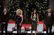 Karen Fairchild looked fab at the Country Christmas concert in a gold peplum dress.
