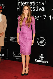 Shailene Woodley looked sweet in a berry pink lace dress at the Dubai International Film Festival.