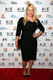 Amanda de Cadenet showed off her curves at the 2011 A&E Television Networks Upfront Presentation wearing a black dress with an asymmetrical neckline.
