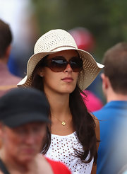 Ana Ivanovic was summer-chic in her oversized sunnies and straw hat at the 2011 Emirates Australian Open.