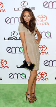 Ashley Madekwe topped off her figure-hugging frock with leopard print platform sandals.