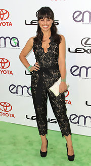 Constance Zimmer kept her accessories simple by pairing her lace jumpsuit with black platform pumps.