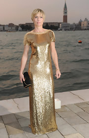 Robin Wright Penn dazzled in a beaded gold dress. The floor-length gown perfectly complemented Robin's short 'do.