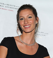 Gisele added a touch of sparkle to her black dress with a diamond necklace.