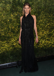 Angela looks dramatic in a black evening gown with glittering streaks at the Green Auction event.