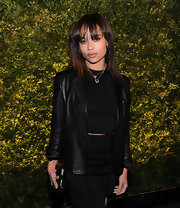 Zoe Kravitz attended the 2011 Green Auction with straight shoulder length hair and bangs that swept across her forehead.