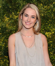 Amanda Hearst paired her sand-hued blouse with a long layered silver neckalce.