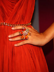Selena Gomez complemented her burnt orange dress with a fire opal and diamond Wild Orchid ring.