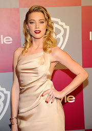 Actress Amber Heard paired her draped satin dress with a Looping Shine ring in white and pink gold with diamonds and champagne topaz.
