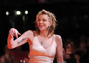 Courtney Love showed off the 'Let it Bleed' tattoo under her arm at the Joyful Heart Gala.