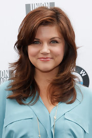 Tiffani Thiessen attended the 2011 Kiehl's LifeRide for amfAR finale wearing her hair in feathery layers.