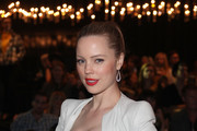 Melissa George Shimmers in a Metallic Corset Dress