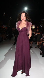 Andy epitomizes glamour at the Melbourne Fashion Festival in a purple strapless gown with a deep sweetheart neckline.