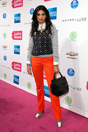 Rachel Roy looked festive at the Lucky Shops party in a gray and navy diamond print sweater and bright red pants.