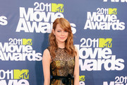 Actress Emma Stone arrives at the 2011 MTV Movie Awards at Universal Studios' Gibson Amphitheatre on June 5, 2011 in Universal City, California.