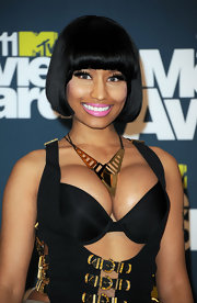 Nicki Minaj wore a cool gold statement necklace with her sexy strap-y top at the 2011 MTV Move Awards.