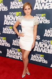 Emma Watson added shine to her little white dress with silver platform Maniac pumps.