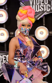 A pale aqua plastic cuff in the shape of a bow was one of the many colorful accessories Nicki Minaj wore at the 2011 MTV Video Music Awards.