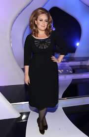 Adele looked elegant at the VMAs in a black cocktail dress with an art-deco inspired neckline.
