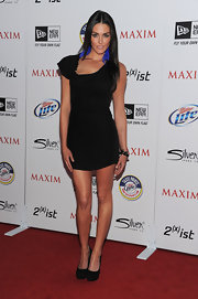 Taylor Cole looked fly at the Maxim Hot 100 party in a sexy LBD with vibrant feather earrings.