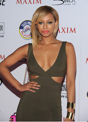 Keri Hilson paired her sexy dress with two chunky bracelets while attending the 'Maxim' Hot 100 party.