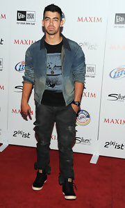 Joe Jonas wore a classic timepiece which he paired with a black onyx and pave black diamond spiritual bead bracelet to the 2011 'Maxim' Hot 100 party.